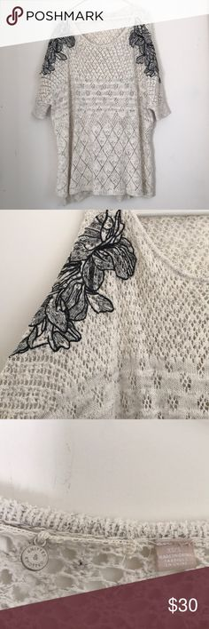 Anthropologie Knitted and Knotted Creme Tunic This is so beautiful! Knitted and Knotted by Anthro. Embroidered black flowers on the side. Size XS-S. Anthropologie Tops