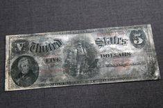 A five dollar bank note, series 1907, from the RMS Titanic Inc. is on display at Guernsey's Auctioneers & Brokers.    Read more: http://www.nydailynews.com/news/titanic-sinking-100-years-rms-titanic-artifacts-auctioned-gallery-1.1058798#ixzz1tiqnPoa7