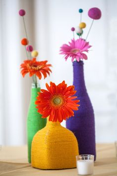Yarn-wrapped bottle centerpieces #Muppet #Wedding #RainbowConnection