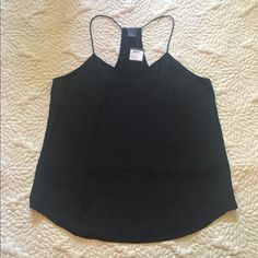 Club Monaco silk tank sz M NWT Goes with everything (except my chest haha) - I so wish this worked in me but it doesn't.  Strapless or no bra required on this one  Club Monaco Tops Tank Tops