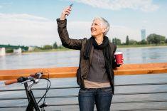 Happy Mature Woman Making Selfie. stock photo