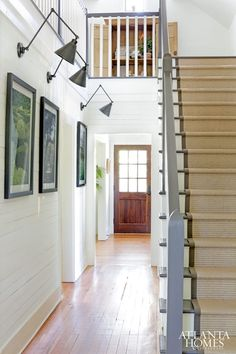 Entry with swing arm sconces and shiplap walls | Alex Smith Garden Design | Atlanta Homes & Lifestyles