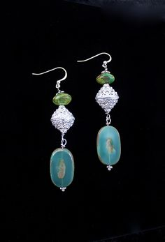 """""""Dramatic Dangle"""" earrings, made of Green Turquoise, glass and Sterling Silver.  Gorgeous and long-perfect for all lengths of hair.  Green is in, so go for it!  $65.00 #spitfire designs."""
