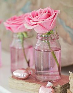 jars with rose cuttings. simple and bring some much beauty to a room.