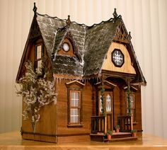 I have just finished making my first dollhouse. It is THE ORCHID  dollhouse from CORONA CONCEPTS . I decided to leave the house unpainted,...