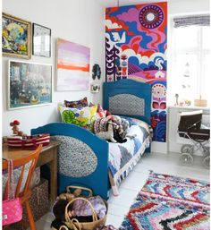Multi patterned eclectic girls room. Painted bed and wallpaper panel.