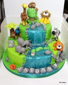 I had so much fun making this cake. T.he little boy's mum told me that she wanted a jungle cake with animals, so I went the extra mile and gave her a glistening waterfall too.