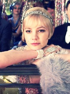 The Great Gatsby is all about fashion - a fancy hairband, pearls, fur