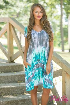 This bold tie dye printed dress is simply perfect for a day of fun at the beach or a backyard bonfire! Wherever you go, this bold print - featuring teal, mint, black, blue, white, and grey - will stand out from the crowd!