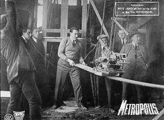 Fritz Lang mans a sliding camera on the set of Metropolis.