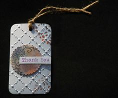 Embossed 'thank you' tag,