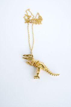 Dinoriffic gold dinosaur skeleton necklace. $22.00, via Etsy.