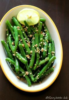 This healthy snack of roasted fresh tender green beans was on the dinner table along with a large vegetable Pizza.