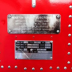 A close up of the sign on a restored Martin - Baker ejector seat from  the 1950's.