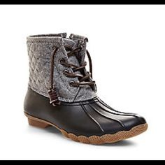 Nib/Tillis - Grey Multi Steve Madden/Boots/SZ 8R Nib/Tillis/Steve Madden/Grey Multi/SZ 8R/Black Boot w Grey Shaft/Side zippers/Always be ready for whatever the elements throw your way with TILLIS. Waterproof boots feature a lace-up vamp with quilted side panels.  Sure to keep you dry without sacrificing a drop of style. PU upper material Fabric lining Rubber sole .5 inch heel height 12 inch shaft circumference 5 inch shaft height Steve Madden Shoes Ankle Boots & Booties