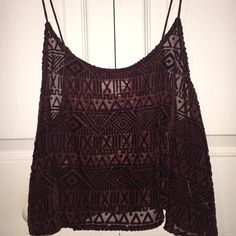 GARAGE Tribal Print Crop Top Maroon tribal print crop top from Garage. Very cute and comfy. If you love to bare a lot of skin and a prefer a loose fit this crop top is perfect for you. I personally didn't know how to style it. So I sadly have to say goodbye to it. Garage Tops Crop Tops