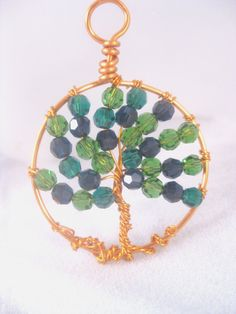 Handcrafted Copper Wire Wrapped Tree of Life Pendant with Emerald and Dark Indigo Swarovski crystals sparklngcreations.etsy.com