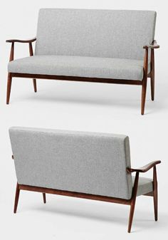This is a unique loveseat and is elegant in every way with it's curved wooden frame.  Features tweed upholstery.  Perfect addition for the mid century modern enthusiast.