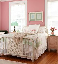 Vintage Charm - Sweet pink walls and vintage furnishings dress this bedroom in homey comfort.