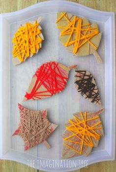Yarn wrap Autumn leaves craft. Practice fine motor skills, learn about textures…