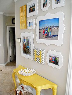 colored picture frames organized beautifully above a bright yellow table... I want to do this in green and white, maybe with hints of coral, aqua or blue