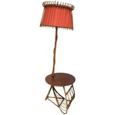 French Bamboo Floor Lamp with Rafia Top Tablet and Magazine Rack   From a unique collection of antique and modern floor lamps at https://www.1stdibs.com/furniture/lighting/floor-lamps/