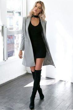 Gray coat over all black.