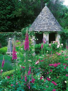 Royal Turret A graceful turret in the corner of garden wall supplies a shady spot to relax and take in the bountiful blooms in this English cottage garden. Diy Garden, Garden Cottage, Pergola, Gazebo, Beautiful Landscapes, Beautiful Gardens, The Perfect Getaway, Garden Buildings, Garden Pictures