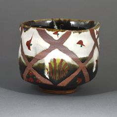 TOMOO HAMADA - Layered brown and white glazes with wax resist crisscross pattern revealing clay body, decorated in Okinawa style overglaze enamels in red, green and yellow.