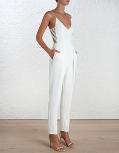Crepe Harness Jumpsuit, from our Spring 16 collection, in Pearl stretch crepe. Harness detail through side of bodice with gold hardware. V neck, shoestring straps and side pockets at hip. Fully lined with centre back zip closure.