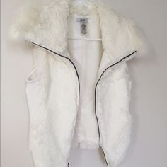 White fur vest Gorgeous Cache white fur vest. Worn once. Contemplated selling this but I never wear it. Needs a new home :) Cache Jackets & Coats Vests