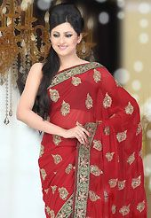 Welcome to the new era of Indian fashion wear. This red faux georgette saree have beautiful embroidery patch work which is embellished with zari, sequins and stone work. This saree gives you a modern and different look in fabulous style. Matching blouse is available. Slight Color variations are possible due to differing screen and photograph resolutions.