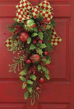 Instead of a wreath. Buy a garland, fold it in half and form into an upside down teardrop , add bow, fillers. and hangar