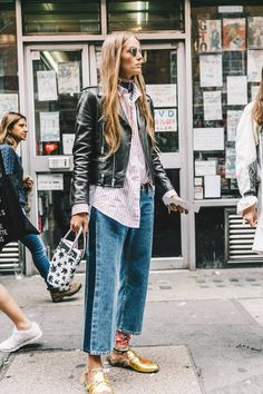 You've probably never thought of these ways to wear your striped shirt. We love this look with boyfriend jeans, a leather biker jacket, and a small top handle bag.