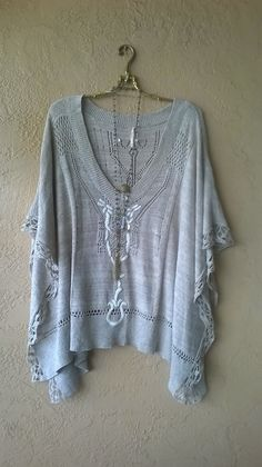 "Image of Rare Free People ""Kona Pointelle Poncho"" from May 2011"