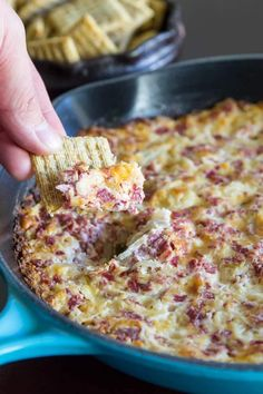 Dip Recipes 468726273711317964 - A photo of a wheat cracker being held up to the camera with hot Reuben Dip in the cracker. The dip is in the background and it is against a dark counter top. Finger Food Appetizers, Appetizer Dips, Yummy Appetizers, Appetizers For Party, Party Dips, Crock Pot Appetizers, Finger Foods, Irish Appetizers, Crock Pot Dips