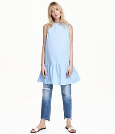 Light blue. Sleeveless A-line dress in cotton poplin. Small ruffled collar around neck, concealed fasteners at back, seam at hips, and wide, flounced skirt