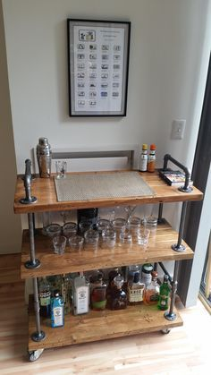 Absolutely love this simple piece.  This is a repost from:  https://www.reddit.com/r/DIY/comments/4a5z6f/industrial_bar_cart_wood_black_pipe/