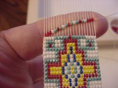 beading bracelets using a loom : : This is my new favorite thing. It's very meditative with all the counting and sorting.