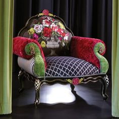 Inspired by Parisian gardens, our Botanica Collection begs to be savored like a stroll through the Jardin du Luxembourg. Over the top, even for us, this suite of lush furniture and decor features oversized blooms rendered in a rich palette and complemented by the familiarity of our favorite MacKenzie-Childs patterns. Crafted of exotic hardwoods, flocked velvet, and sumptuous silk. Step into this indulgent world, and the city outside fades away.