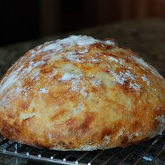Crusty Bread **Ladies, you have to try this! It is so easy and you cook it in a dutch oven!!** YUM!