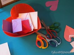 A heart shaped bowl, scraps of paper, folded, with hearts on them. Kids, scissors, fun and great cutting practice