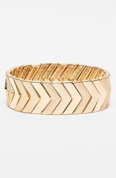 Adding this gold chevron stretch bracelet to the jewelry box.