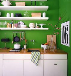 Paint the walls green! Balanced by white cabinets and wood countertops, this kitchen can easily be changed for the next owner with a few gallons of paint