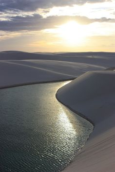 Lençois Maranhenses National Park located in Maranhão state of northeastern Brazil. Composed of large, white, sweeping dunes. Fresh water collects in the valleys between sand dunes, spotting the desert with blue and green lagoons. Has no access to roads, most vehicles prohibited entrance.