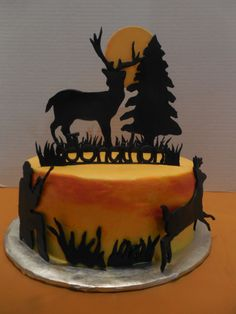 Deer Hunting Cake - This is my version of the amazing cake by steph0511. My teenage son saw hers and fell in love with it. I did my best, and changed a few details. He loved it. Thanks for the inspiration steph0511. I love your cakes! Mine is buttercream, painted to look like a sunset.