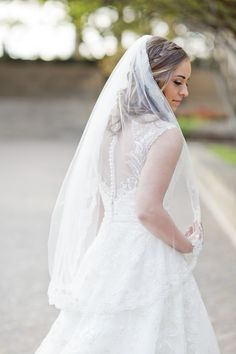 Dallas wedding photographer, Mary Fields Photography, lace wedding dress with sheer button down back, lace waist length wedding veil, bridal portrait pictures