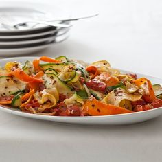 Thin vegetable slices or ribbonsare a simple yet elegant presentation for summer squash and carrots.