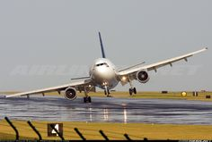 Airbus A310-325/ET landing at Portugal Airport. The pilots were caught in some wind shear and it was near to total disaster, since the wing almost touched the ground. You can also see stress in the main landing gear.