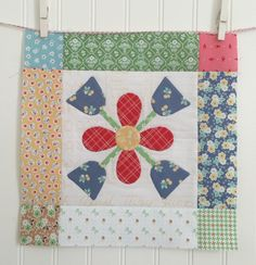 BLOOM Sew Along! 2-by Lori Holt- Lori uses BLOOM set of my Sew Simple Shapes to create appliqué blocks.